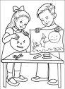 disegno di bambini che colorano le zucche